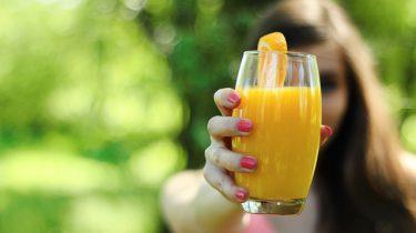 drinken sinaasappel hand