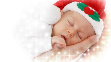 baby met kerstmutsje